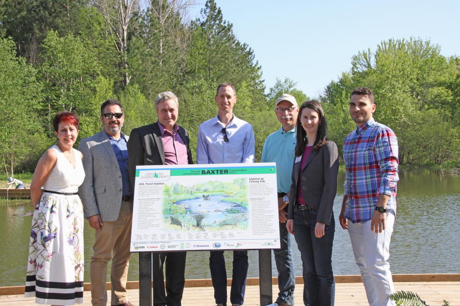 Funders of the Baxter Pond Restoration Project gather to unveil the new interpretive sign developed as part of the improvement efforts — (left to right) Jeanine Maciver (Don Maciver Memorial Fund), Michael Poliwada (former RVCF Executive Director), Adrian Smith (Manager TD Bank, Manotick), Ryan Polkinghorne (Project Manager Surface Water Engineering Support Services, City of Ottawa), Bill McShane (ASL Agrodrain President), Sommer Casgrain-Robertson (RVCA General Manager), Sandro Ricci (ASL Agrodrain Vice President of Business).